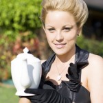 A picture of a woman at a tea party